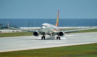 中国南沙美济礁渚碧礁新建机场试飞成功